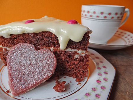 slice of red velvet cake with cup of tea | H is for Home