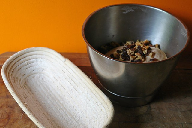 Home-made walnut and sultana loaf dough in a mixing bowl with cane banneton | H is for Home