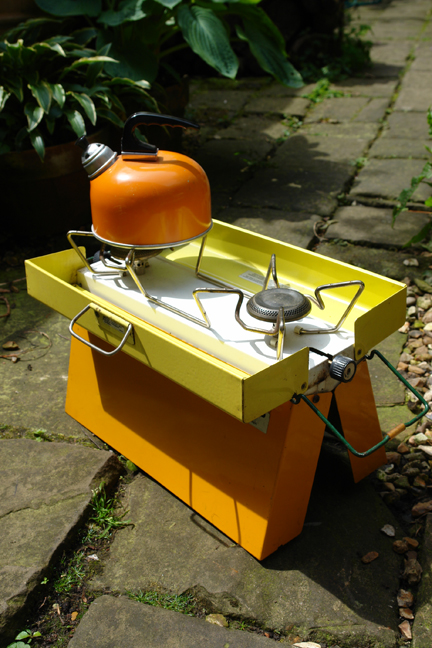vintage yellow and orange Primus stove