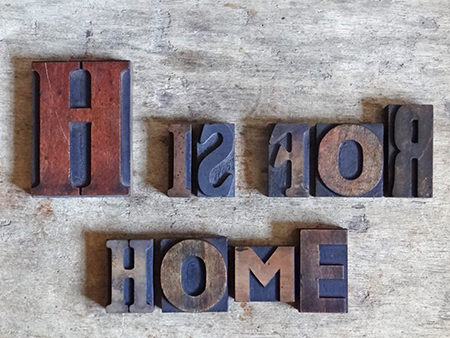 set of wooden vintage printing blocks spelling out H is for Home