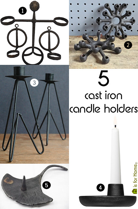 selection of 5 cast iron candle holders