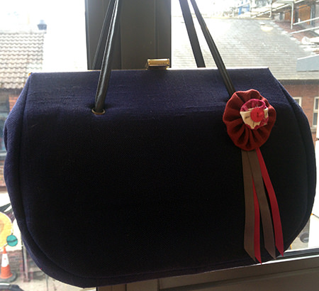 Completed Suffolk puff on my handbag