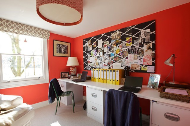 Home office with coral painted walls