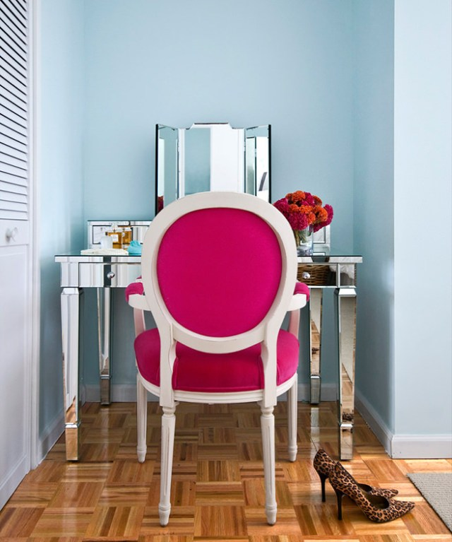 Dressing room with chair upholstered in hibiscus pink fabric