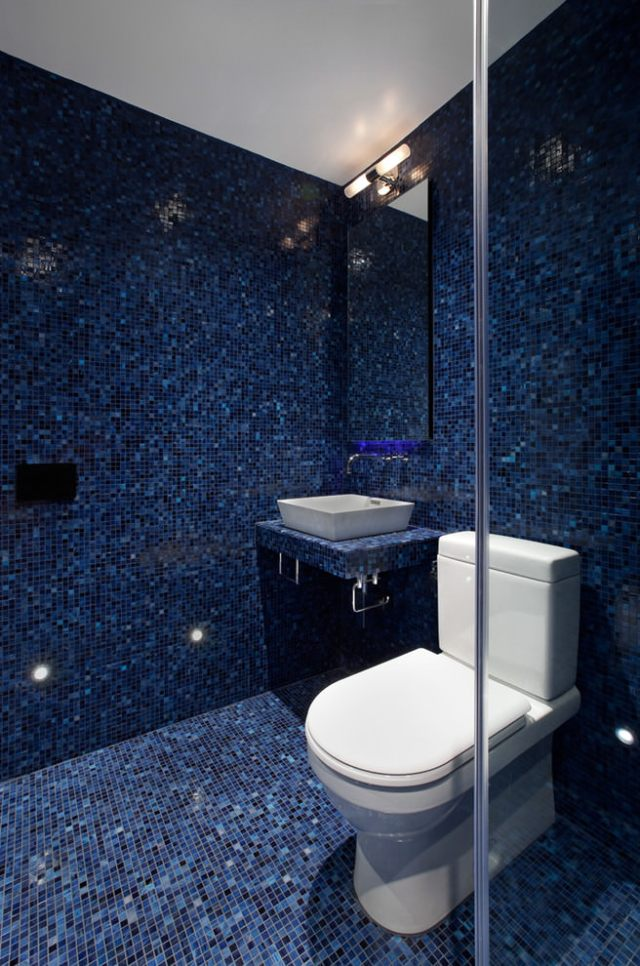 Wet room tiled in indigo mosaic