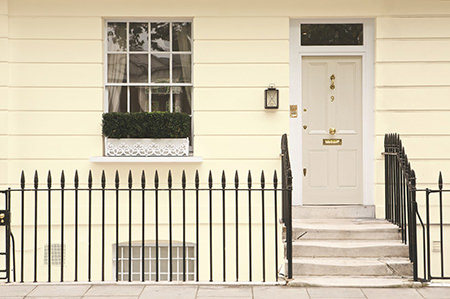 Front door painted in Farrow & Ball's 'Skimming Stone'