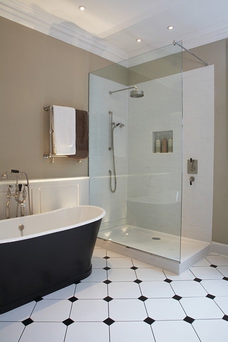 Bathroom with khaki-painted walls and black & white tiled floor
