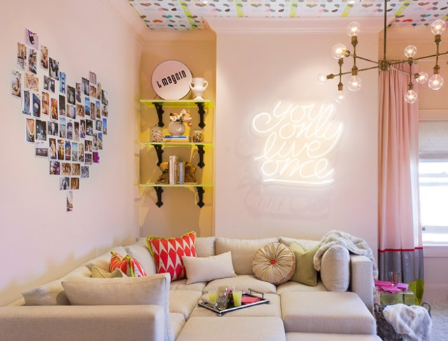 'You only live once' neon sign above a sofa in a sitting room