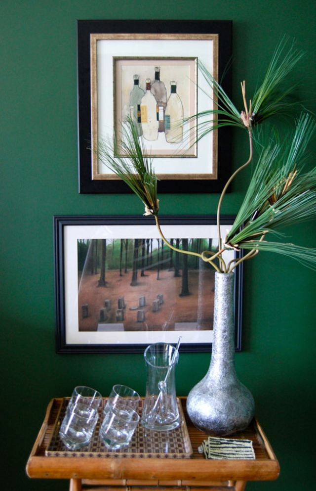 Vignette in front of a racing green painted wall