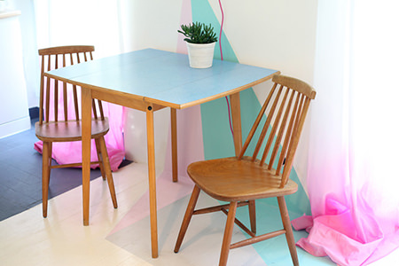 sugared almond colour painted wall and floor with vintage table & chairs