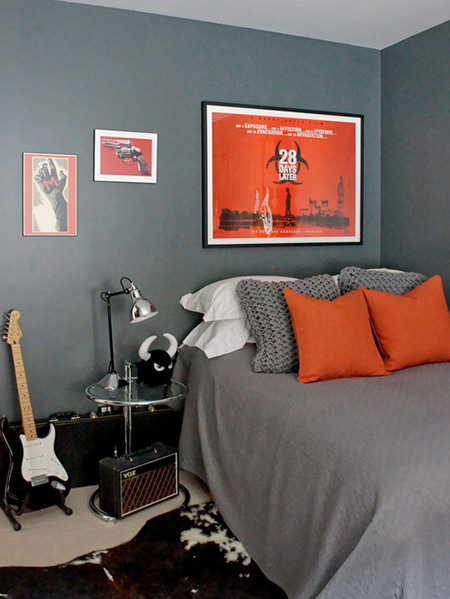 teenager's bedroom with grey & tangerine bedding and tangerine poster