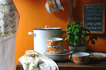 Orange wall in our kitchen with Skinny la Minx apron and tea towel with Pontessa crockery
