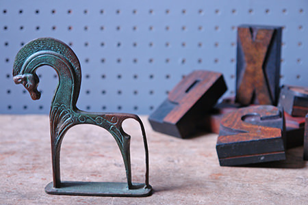 vintage brass horse and wooden printers letters