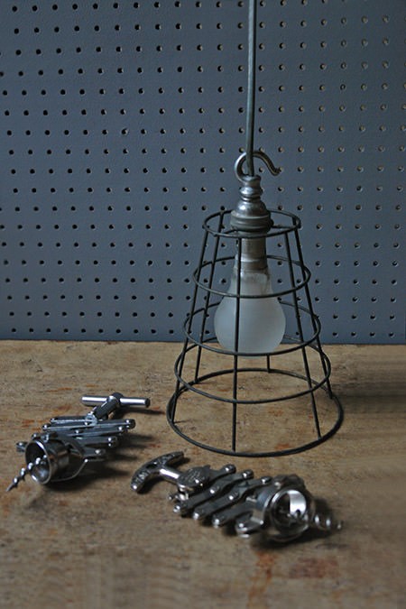 vintage metal corkscrews and vintage industrial task light