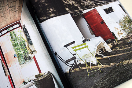 page from the 'Artistic Idyll' feature showing the outdoor patio area from the launch issue of Elle Decoration Country