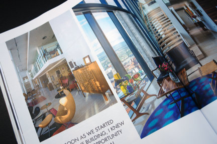 page showing living room and kitchen in Ian Sipmson's apartment in Manchester's Beetham Tower featured in the Elle Decoration September 2013 magazine