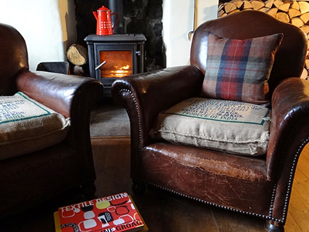 Pair of antique leather armchairs in front of the fire