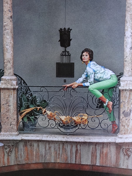 Model wearing green Capri pants in Vogue Magazine, February 1962