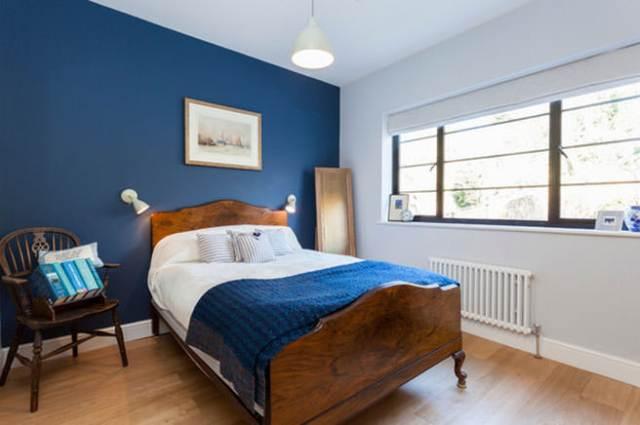 Blue-painted bedroom