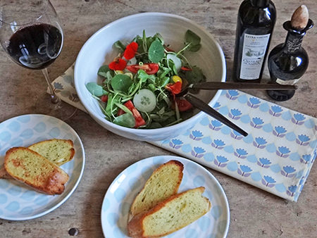 Salad and garlic bread served on Duckydora 'Sienna' tableware with 'Florence' tea towel