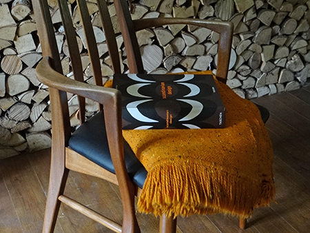 Vintage Eva chair by Koefoeds Hornslet of Denmark with Scandinavian Design book and orange throw