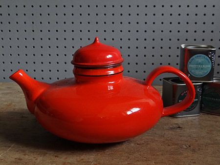 Vintage orange Rörstrand Pop teapot with tins of tea