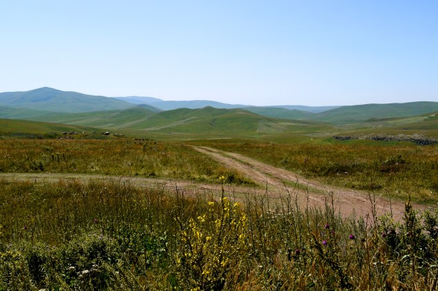 Sprawling green hills and empty Armenian dirt roads - Armenia