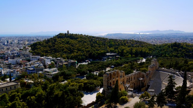 View over the city with the Odeon of Herodes Atticus in the foreground - Athens, Greece