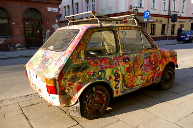 Graffiti covered car, on Józefa - Krakow, Poland (1)