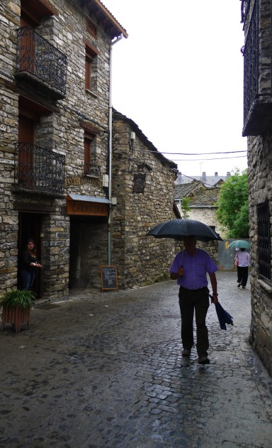 Using umbrellas against the rain, taken on Calle Francia - Torla, Spain (7)