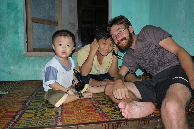 Jon and Vietnamese kids listening to his iPod