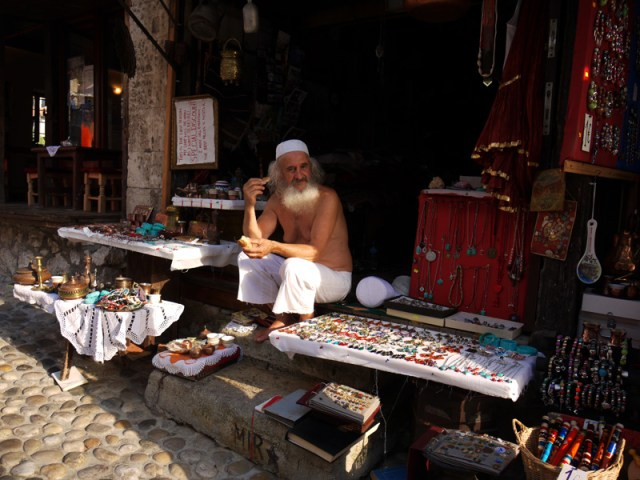 Old souvenir vendor in Mostar, Bosnia and Herzegovina