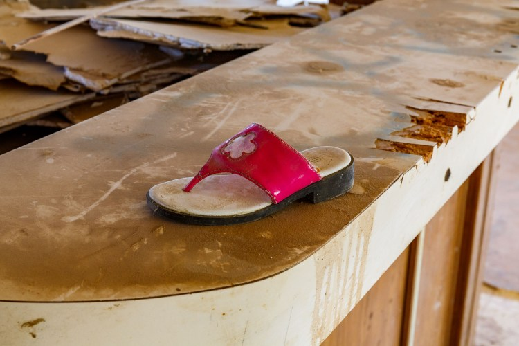 A lonely sandal sitting on a counter in an abandoned building in Bombay Beach
