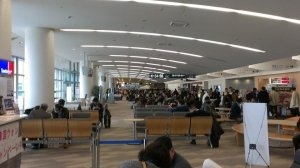 Crowded but modern international terminal during the late morning