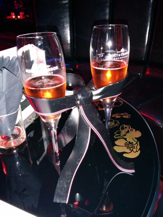 Free Moet champagne if you're seated at a table. Cool glass holder too.