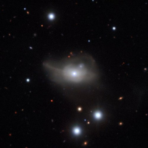 This image from the MUSE instrument on ESO's Very Large Telescope shows the active galaxy Markarian 1018, which has a supermassive black hole at its core. The faint loops of light around the galaxy are a result of its interaction and merger with another galaxy in the recent past.