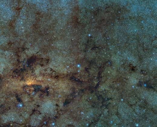 This image, captured with the VISTA infrared survey telescope, as part of the Variables in the Via Lactea (VVV) ESO public survey, shows the central part of the Milky Way. While normally hidden behind obscuring dust, the infrared capabilities of VISTA allow to study the stars close to the galactic centre. Within this field of view astronomers detected several ancient stars, of a type known as RR Lyrae. As RR Lyrae stars typically reside in ancient stellar populations over 10 billion years old, this discovery suggests that the bulging centre of the Milky Way likely grew through the merging of primordial star clusters.