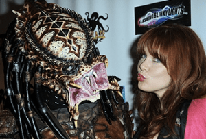 Cosplayer William Blagg dressed as the predator and actress Maitland Ward