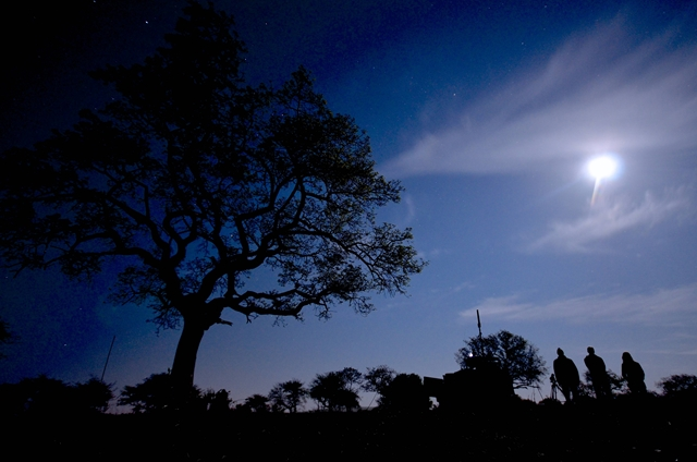 The full moon illuminates this Sabi Sands landscape, presenting shillouttes of marula trees and the crew. (Photo: Jeandre Gerding0