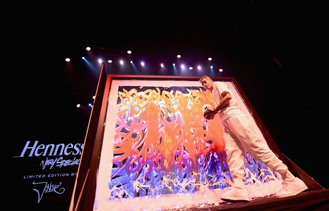 NEW YORK, NY - JULY 11: Urban artist JonOne brings color to the mix at the Hennessy V.S Limited Edition by JonOne Launch Party at Terminal 5 on July 11, 2017 in New York City. The Limited Edition release by JonOne, which features a colorful, vibrant design, is the seventh in an ongoing series of collaborations between Hennessy V.S and several internationally renowned artists. (Photo by Ilya S. Savenok/Getty Images for Hennessy)