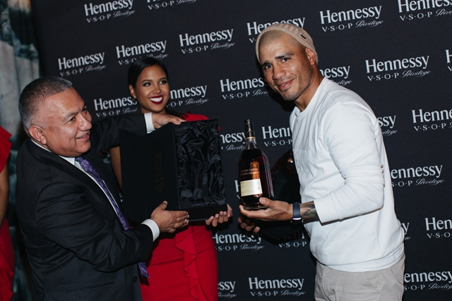 Manny Diaz of Hennessy presents the Hennessy V.S.O.P Privilège Award, and an embossed bottle and a check donation to Mario Cotto