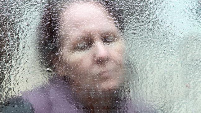 Woman looking through glass