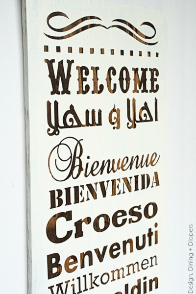 Multilingual Wood Welcome Sign