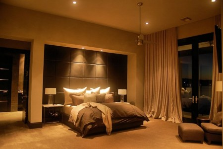 calmly master bedroom lighting ideas with pillow and brown bed cover on queen size bed under lighting mount on the wall and table lamp bed side on cream odyssey wool rug