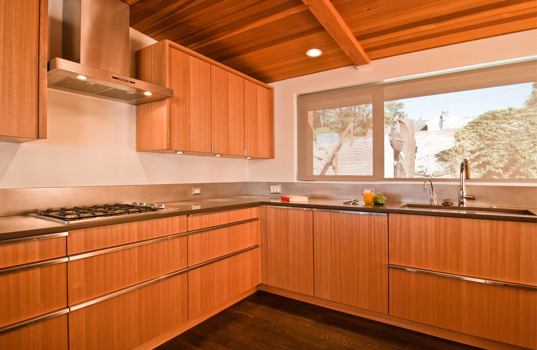 simple mid century modern cabinets with minimalist metal handles sink and faucet a gas stove