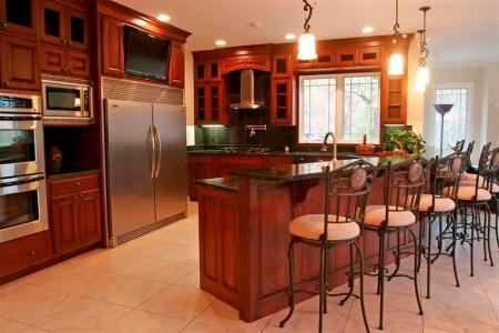 a modern kitchen plan presented black marble kitchen countertop black ceramic tiles for backsplash an arrangement of barstools a kitchen island with sink and faucet some fixtures of pendant lighting