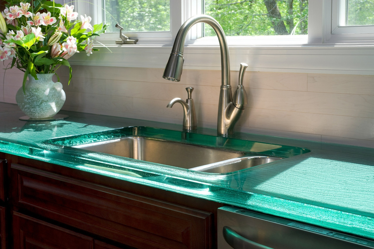 best kitchen sink material in tasteful style plus modern steel faucet and glass countertops and pretty flower vase