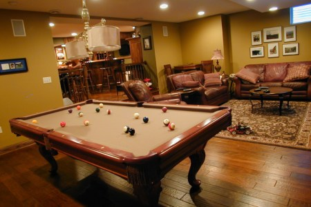 interior design games for adults and adorable game room for adult with yellow scheme and pool game plus hardwood floor plus brown leather sofa