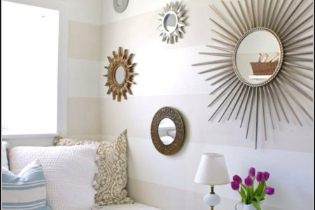 gorgeous white loft living space idea with white cream banquette beneath gl window with sun wall mirror and half circle coffee table for nicole miller home decor