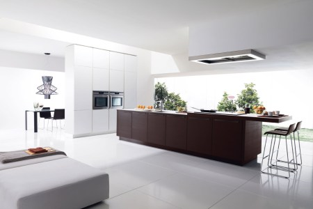modern and minimalist italian kitchen design with indoor plants and bar seating and white pouff for couch and open plan and ceiling lamp